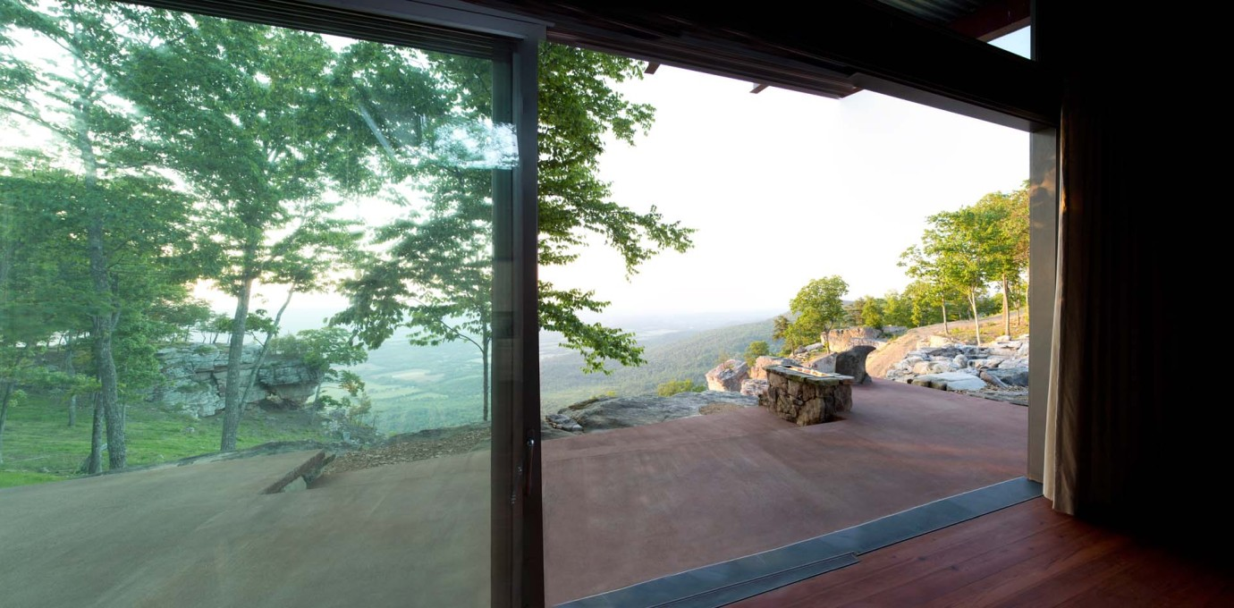The house orients north with an all glass wall that acts as a camera lens, focused on the valley below.