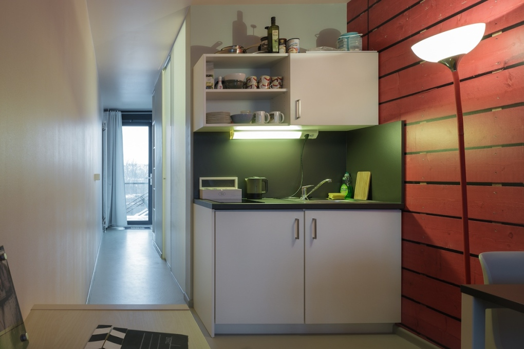 Both the bathroom and the kitchen of each container is located to one side in middle of the space allowing, in the case of the single container units, the maximum amount of light possible the enter.