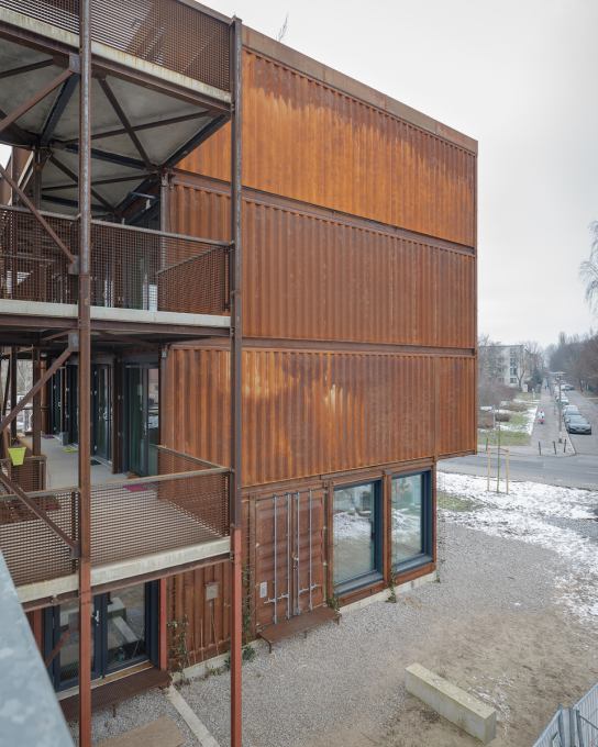 "The 40 ft ""high cube"" is cantilevered stack of containers that houses the site's main office..."