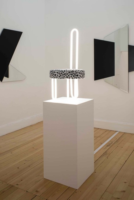 ...is displayed in the final room in the exhibition, its faux dalmatian skin seat and neon-tube back placed high on a plinth. (Photo: Primula Bosshard)