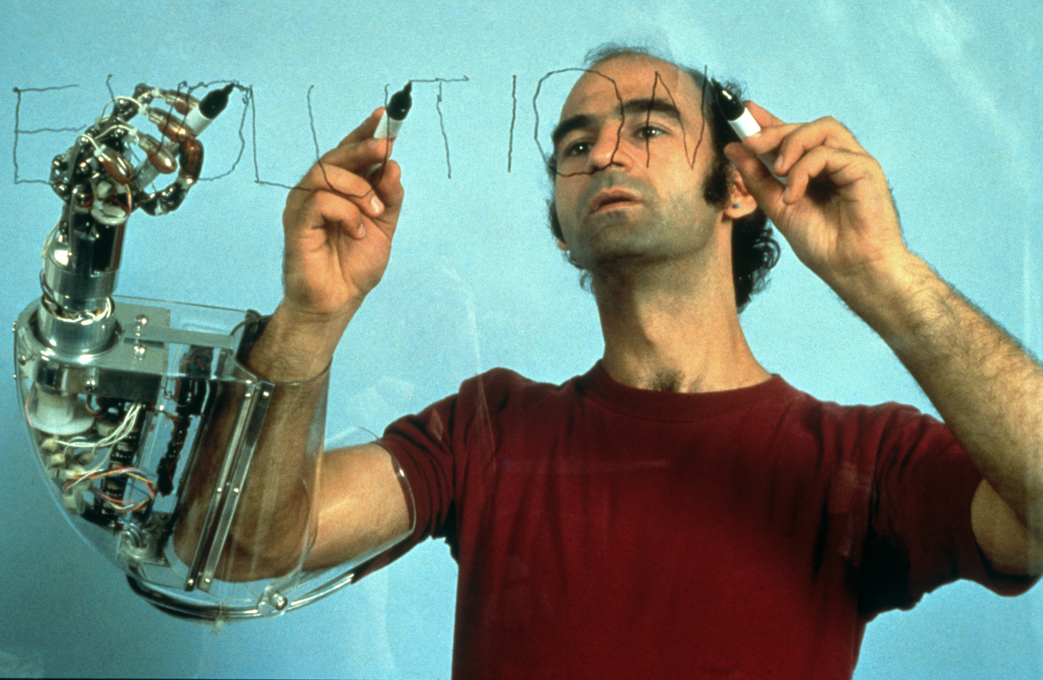 "The artist Stelarc is perhaps the most notorious experimenter with meshing technology and the human body: ""Handswriting"", Maki Gallery, Tokyo, 1982. (Photo: Keisuke Oki)"