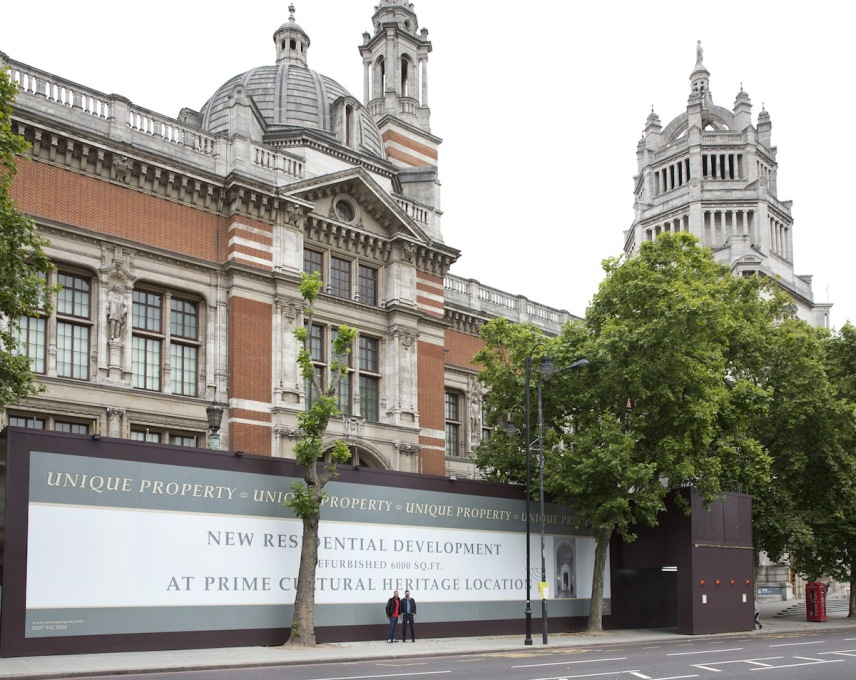 The V&A ripe for redevelopment. A hoarding outside – similar to those seen all over London in the continuing high-end property boom – advertises its conversion into a new residential development. © Victoria and Albert Museum.