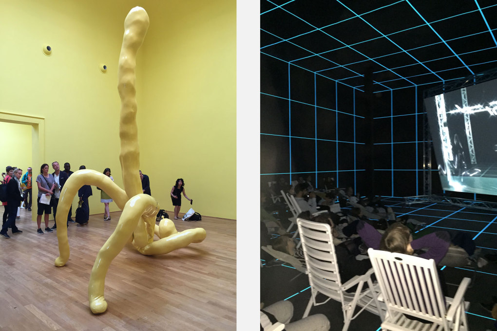 "Large yellow and erect sculpture of Sarah Lucas' in the British Pavilion and Hito Steyerl's video ""The Factory of the Sun"", 2015 in the German Pavilion."