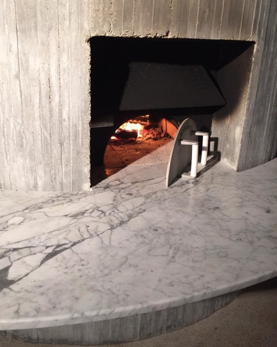 ...and lower down a built-in pizza oven on the outer side of the concrete spiral core. (Photo: Christian Wassmann)