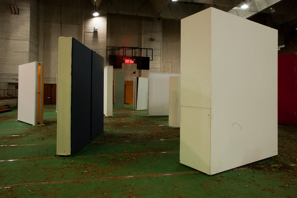 """Cousins,"" an installation by Gabriel Lester, is an array of walls extracted from major European cultural institutions installed in the basketball court. (Photo: Robertas Narkus)"