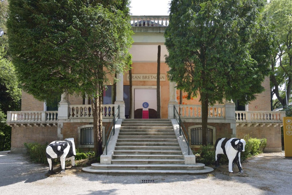 The entrance to the British Pavilion is guarded by two fibreglass, reinforced concrete cows imported from the 1970s New Town, Milton Keynes. (Photo: Cristiano Corte / British Council)