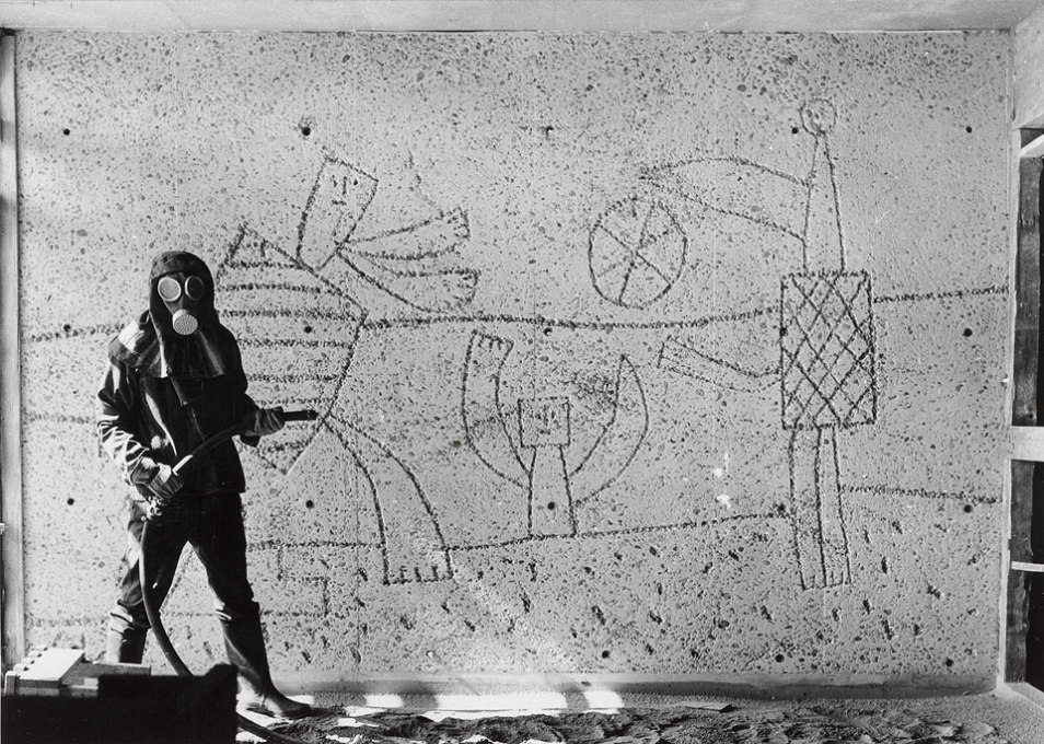 "One of Pablo Picasso's murals, on which he worked with the Norwegian sculptor Carl Nesjar, being sandblasted in Erling Viksjø's ""H-Block"" building, now slated for possible demolition due to bomb damage. (Photo: ukjent, ca. 1957)"