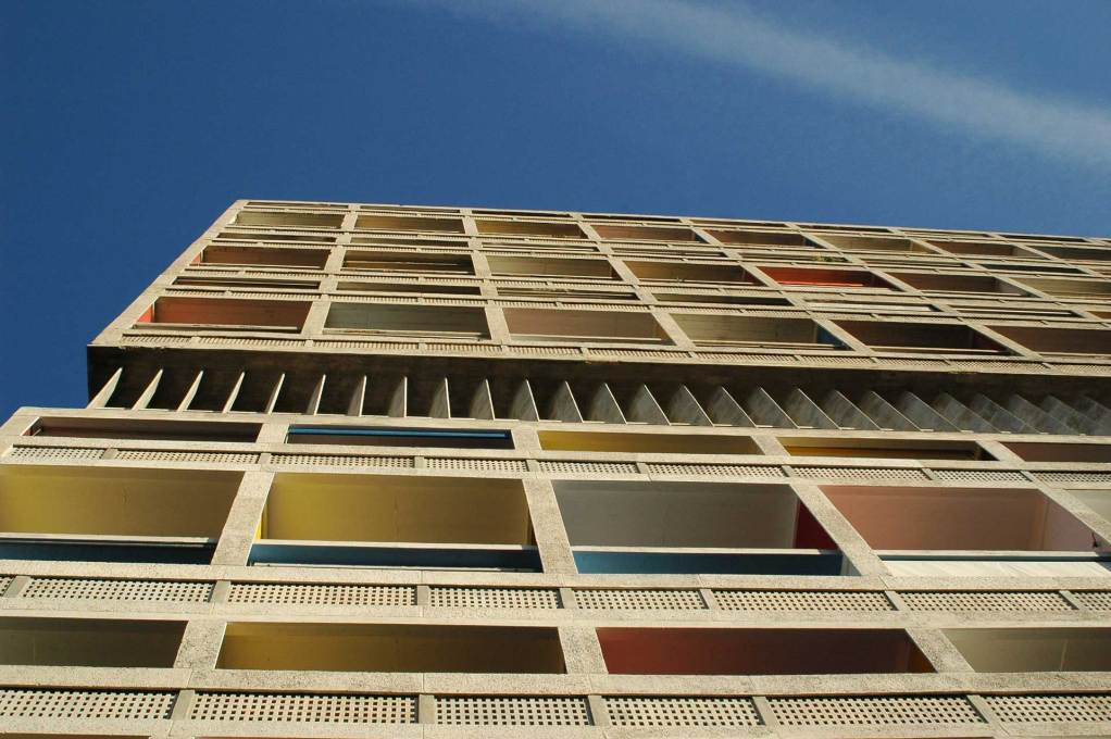 Looking up the façade of the La Cité Radieuse, modelled in the strong Mediterranean sun. (Photo: Philippe Savoir / Fondation Le Corbusier / ADAGP, Paris, 2013)