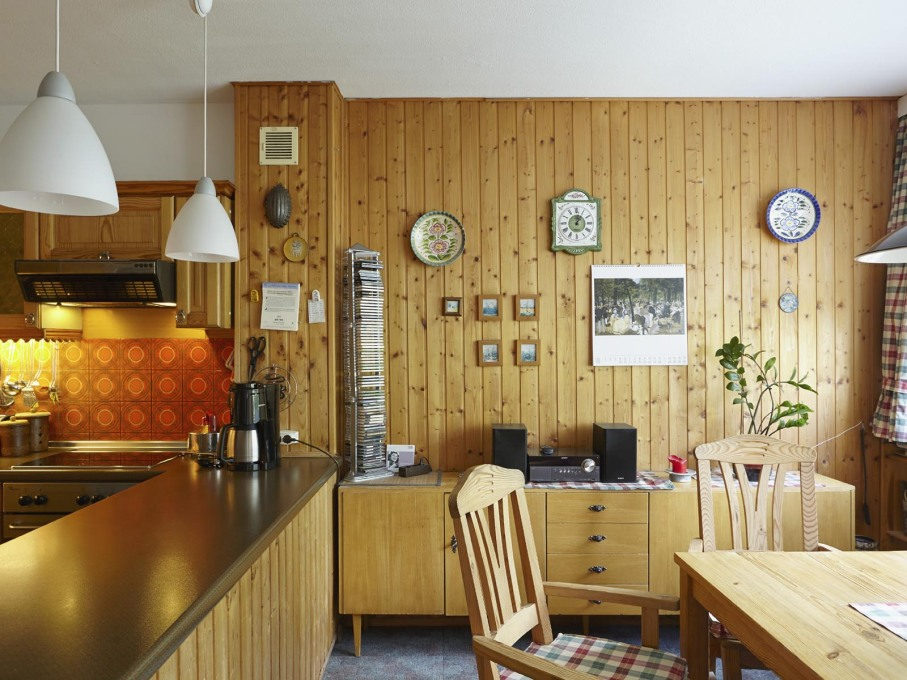 The Bätz apartment features many historical layers, like the 1980s wooden panels in the kitchen area.