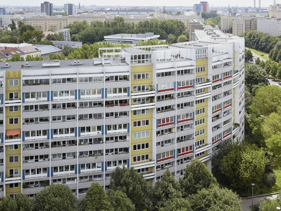 "On the 17th floor, we look out onto the neighbouring ""snake"", one of the few curved prefab blocks of the GDR."