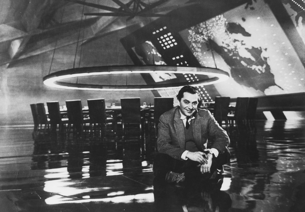 "... and back in 1964 in his legendary set of the War Room for Kubrick's ""Dr. Strangelove"". (GB/USA 1964, Photo © with thanks to the SK Film Archives LLC, Warner Bros. and University of the Arts London)"