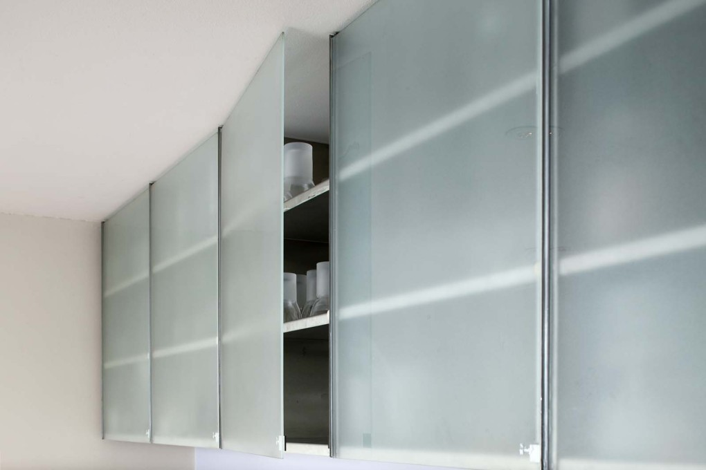 Home of mart van schijndel uncube for Glass kitchen cabinet doors