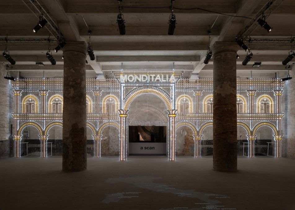 "The entrance to ""Monditalia"" in the Cordiere. Roll up! Roll up! It's showtime! Luminaire structure designed by OMA with Swarovski. (Photo: Gilbert McCarragher)"