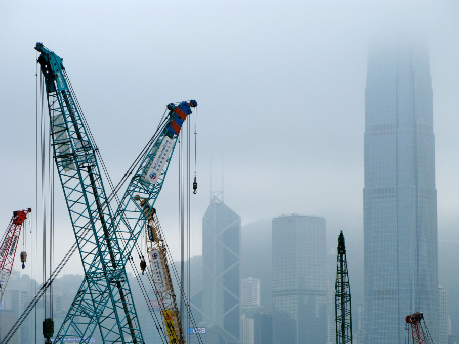 The M+ construction site with Hong Kong's skyscrapers across the harbour.