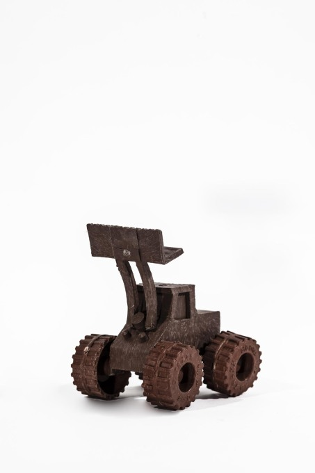 Tingatinga – a child's toy digger made from melted plastic poured into wooden or aluminium moulds. (Photo © Francesco Giustu and Filippo Romano, LaTriennale di Milano)