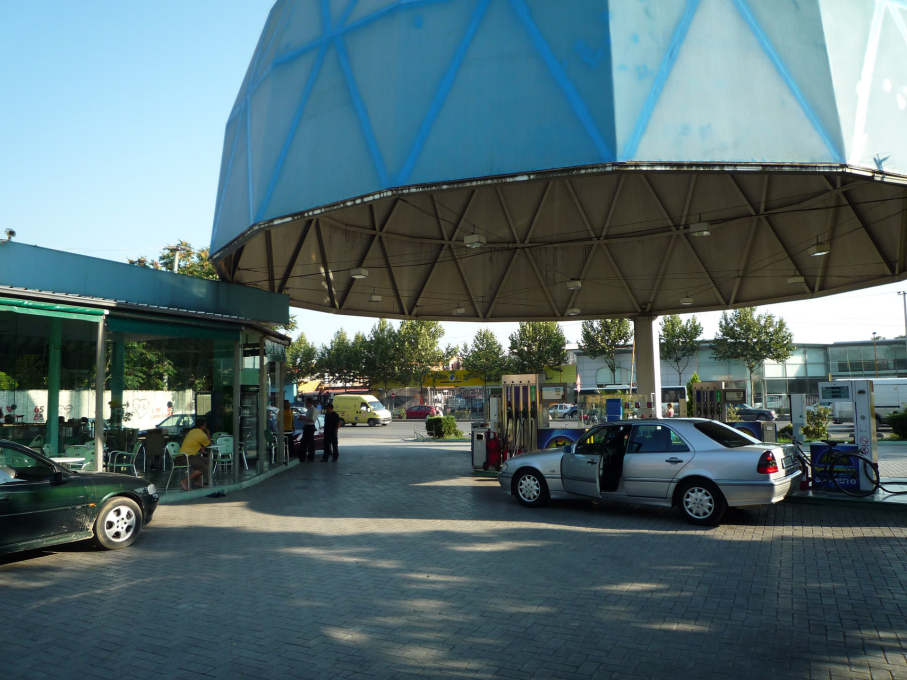"""...a monumental steel cupola floats above a small clutch of petrol pumps..."""