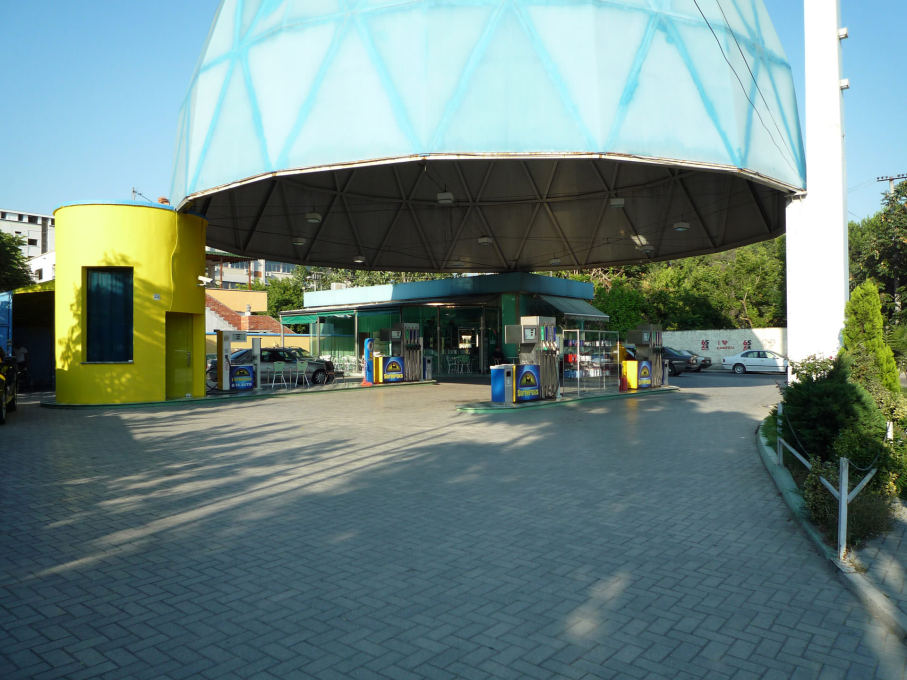 The Europetrol station designed in 2005-2006 is situated along the biggest approach road to Tirana from the airport, its huge floating dome supported at three points, one the service station with a café, one a car wash.