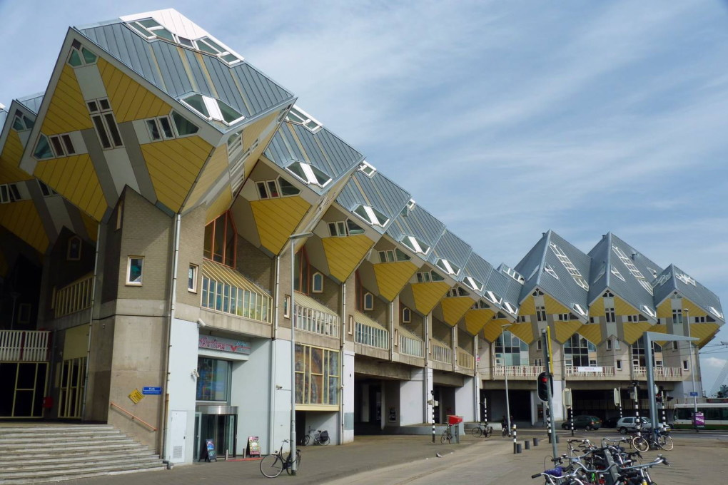 "Much like their ""angular cousins"" in Rotterdam, the ""kubuswoningen"" by Piet Blom, also completed in 1984. (Photo: Cmglee/Wikimedia Commons License)"