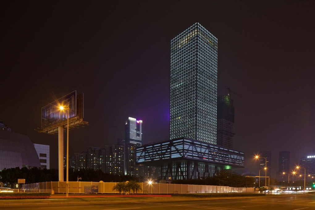 Shenzhen Stock Exchange at night. While proudly defying gravity, it still complies with traditional rules of cosmic harmony: a perfect symbol for the new China. (Photo: Philippe Ruault, courtesy OMA)