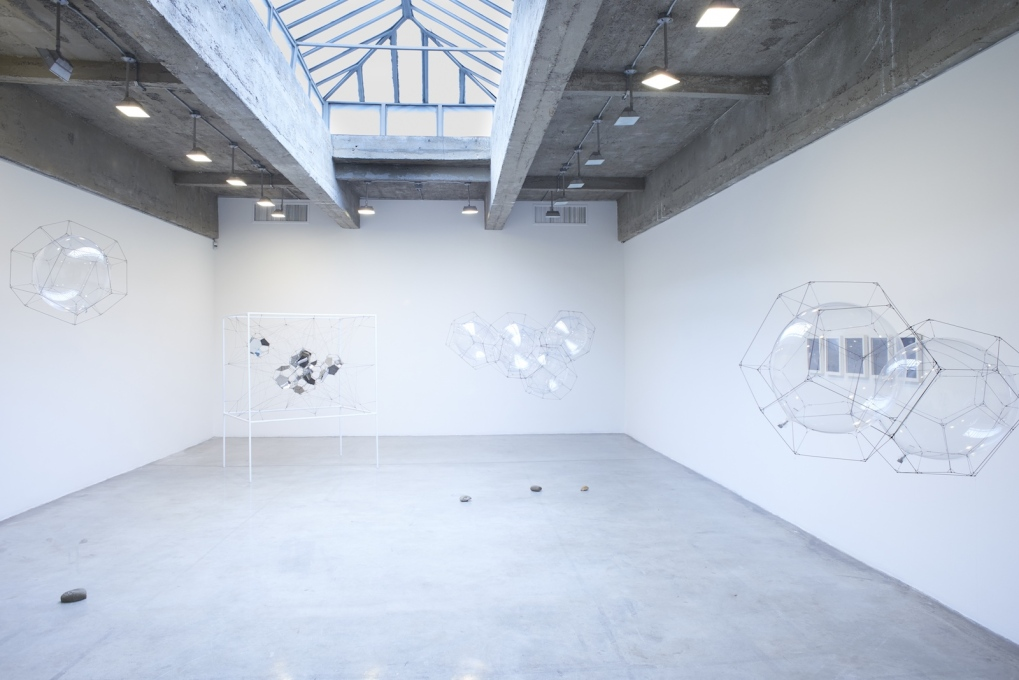 Installation view of earlier work by Saraceno is on view in Gallery 2.