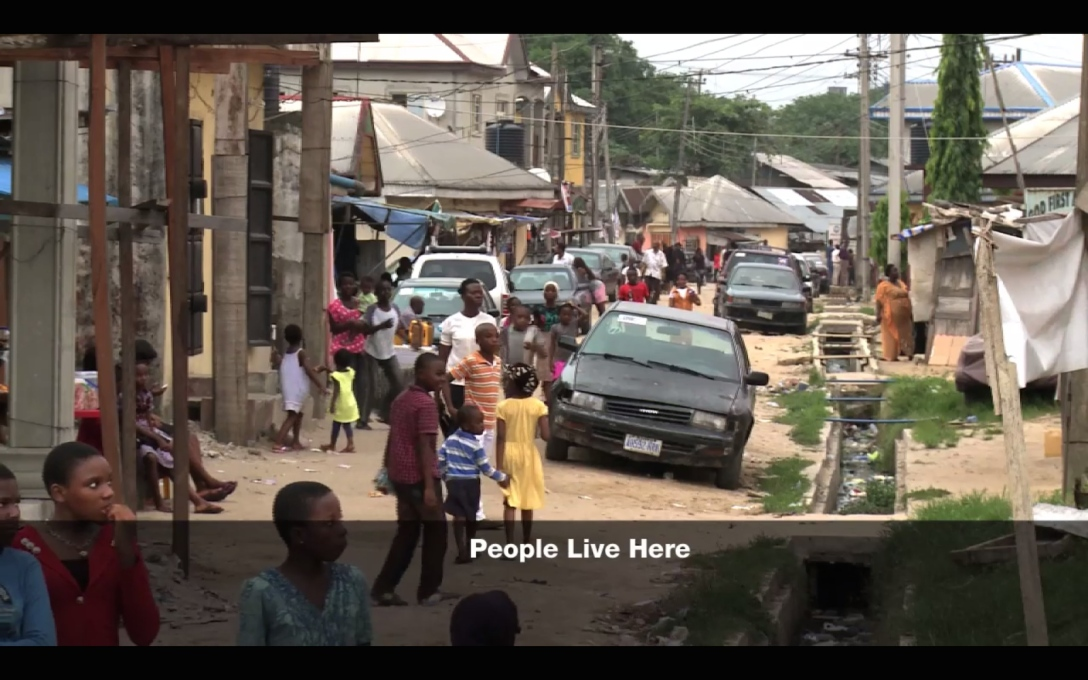 Does it favour improving the living conditions of the people living in the slums...