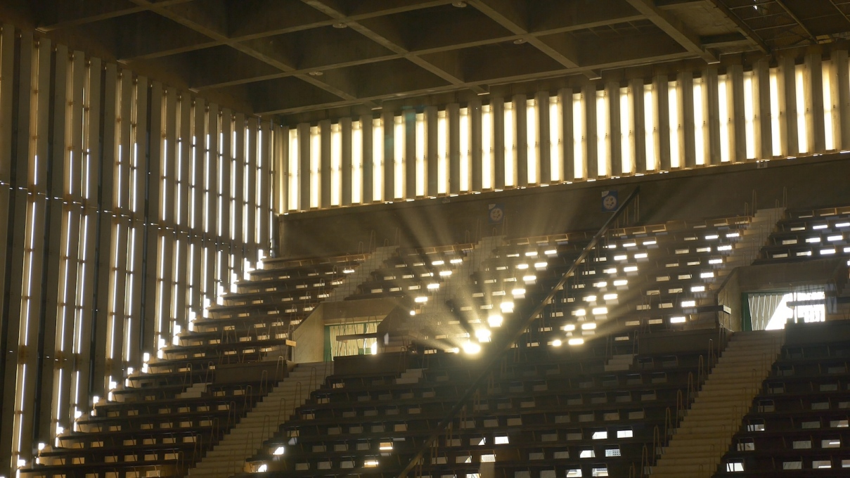 "Light flooding into the interior of the indoor hall today: showing the genius  of Vann Molyvann's architecture. Film still from the forthcoming documentary ""The Man Who Built Cambodia"" (© Balrom Films)"
