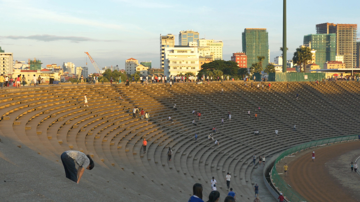 "The stadium provides a valuable quiet public space for couples to meet, rare in the city. Film still from the forthcoming documentary ""The Man Who Built Cambodia"" (© Balrom Films)"