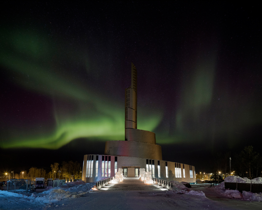 The titanium-clad façade reflects the sky in the day and the Northern Lights during the long periods of Arctic winter darkness. (Photo: Adam Mørk)