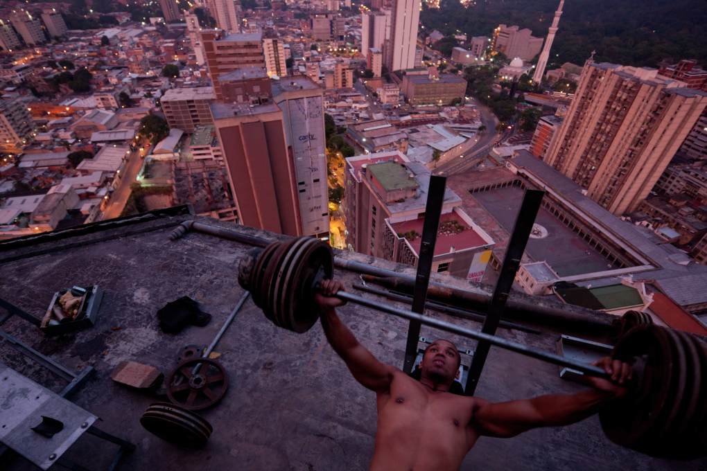 """Pumping iron on the 28th floor of the Torre David"", Caracas. (Image: Iwaan Baan, courtesy Verso)"