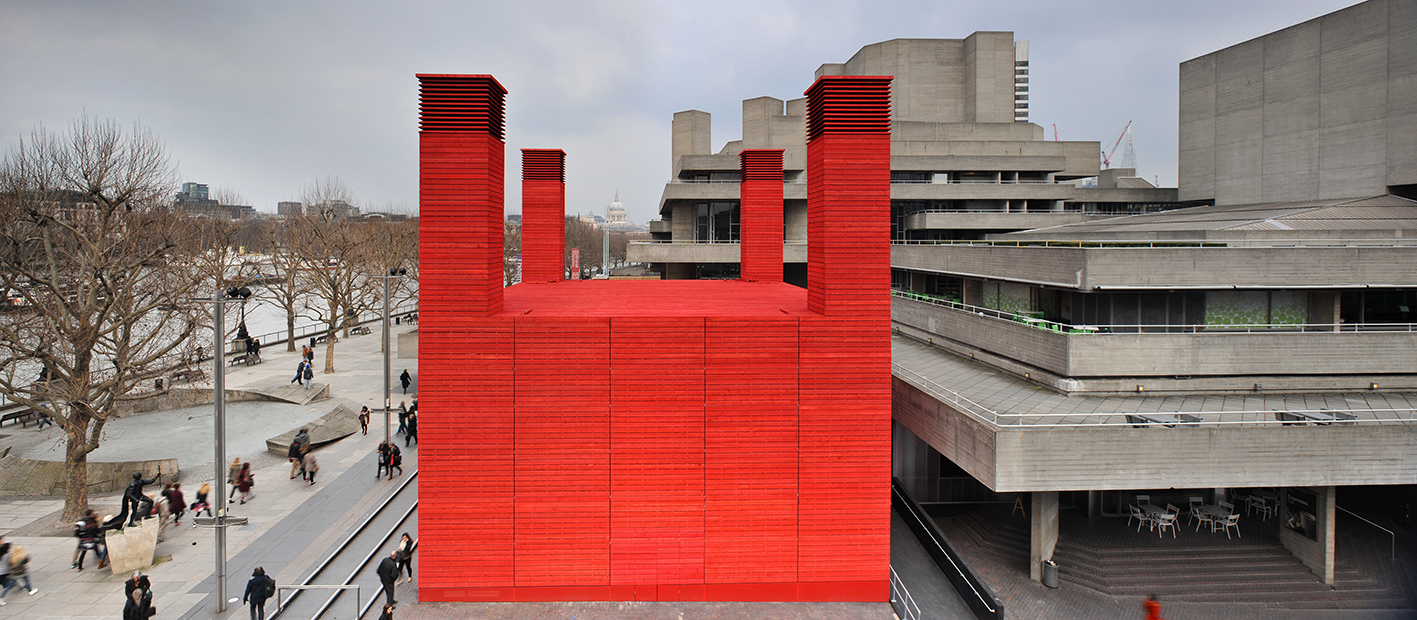 The red shed creates a huge contrast with its concrete surroundings. (Photo © Philip Vile)