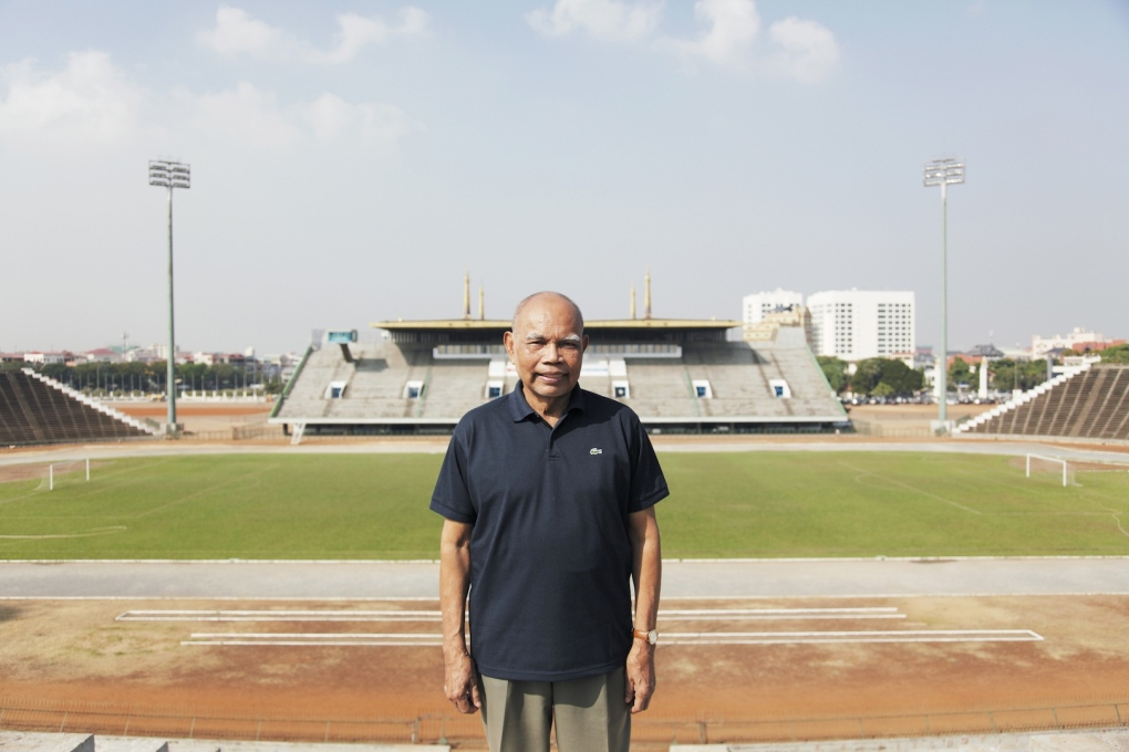 The architect Vann Molyvann standing on the tribune of the National Sports Complex in 2009. (Photo: Luke Duggleby)