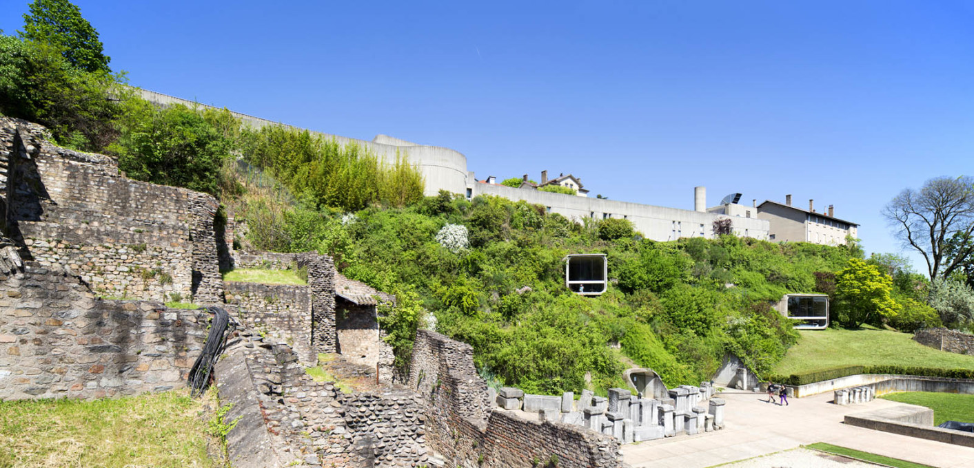 The museum sits embedded into the hillside alongside the ruins of a Roman amphitheatre.