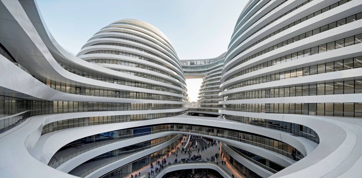 """...the project's central public space, an outdoor retail mall in the ""valley"" between the four towers. Hadid describes it as a gesture to traditional Chinese courtyard buildings...""  (Photo: Hufton + Crow)"