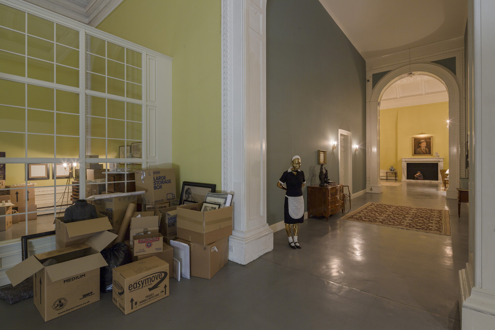 ...to impending bankruptcy. Packing cases await the clearance and sale of the house - as does a scary golden-faced maid. © Elmgreen & Dragset, photo: Anders Sune Berg, courtesy the artists and Victoria Miro