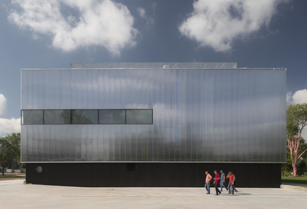 ...allowing OMA to install striking new features, such as the translucent polycarbonate façade.