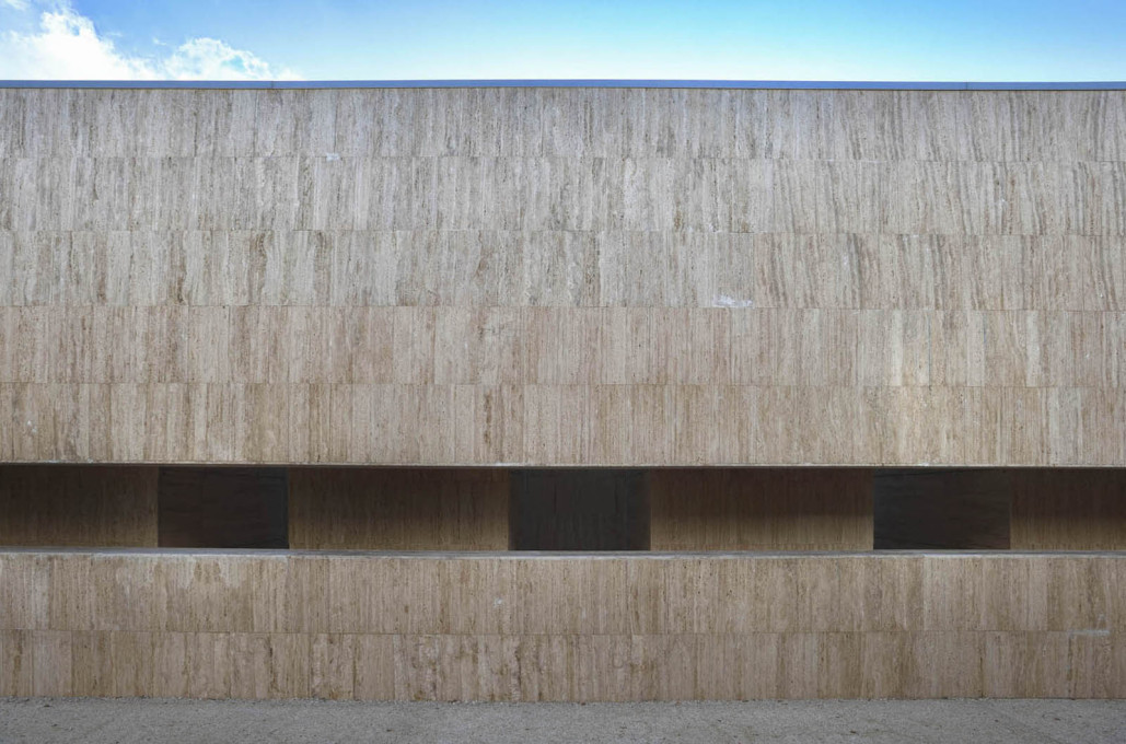 Locally sourced travertine is used as the main cladding. (Photo: Massimo Marini)