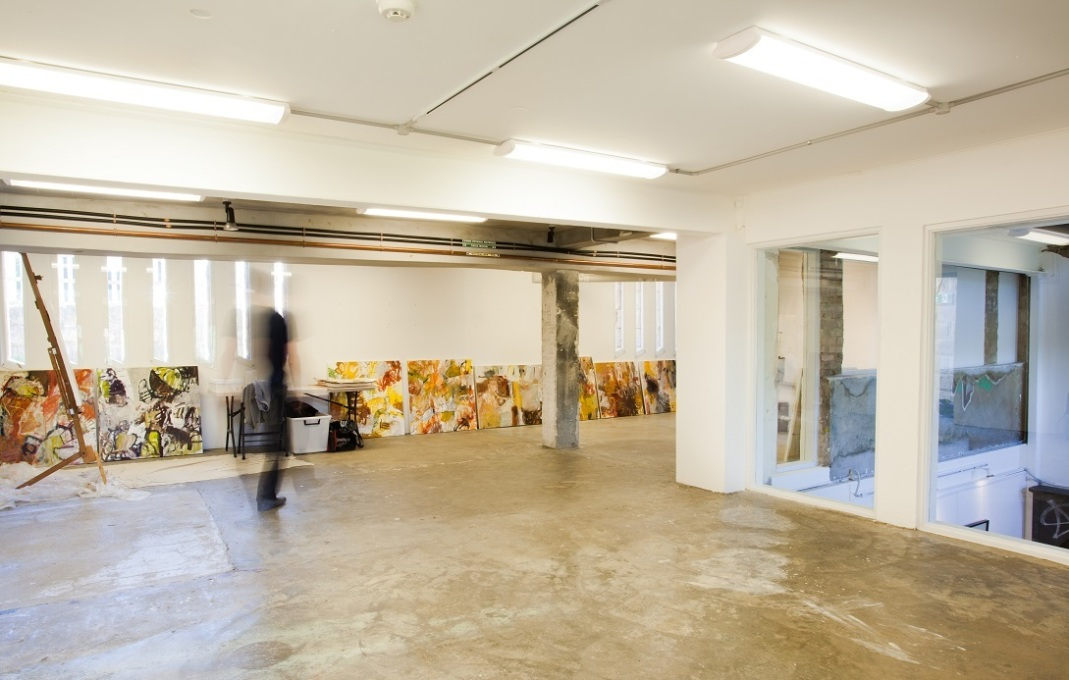 Inside the artist-in-residence studio, showing its internal windows which look into the double height void above the gallery space below. (Photo: Brett Winstone)