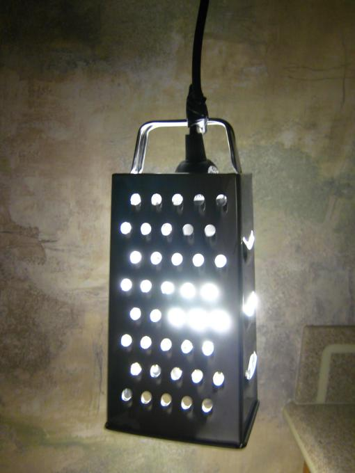 An IDEALISK cheese grater transformed into a lamp in under ten minutes, by hacker K McF. (Courtesy IKEAhackers)