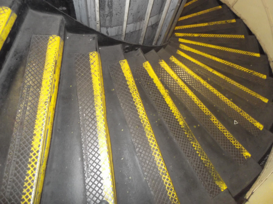 The tread of the spiral-stair at Elephant and Castle is worn - the steps are used regularly by commuters, though the climb up is 123 steps! (Photo: Flickr user thermostinept)