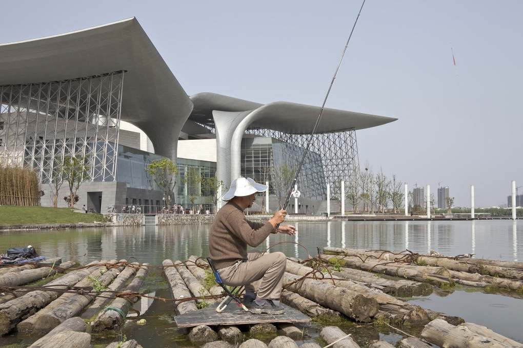 Wuxi′s new cultural landmark, the Grand Theater, hovers on the edge of Taihu Lake - it also hovers on the edge of integration with local culture. (Photo: Kari Palsila © PES-Architects)