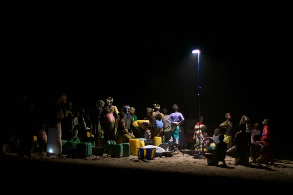 Women collect water from a fountain at night in a Malian village. (All photos © Matteo Ferroni)