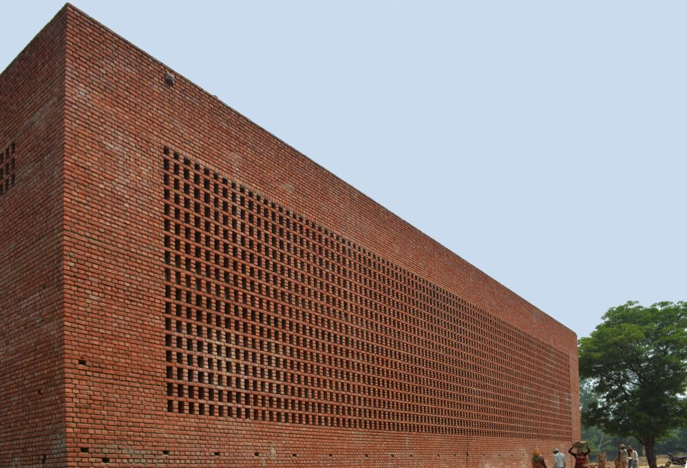 The warehouse and the loading bay feature an outer façade of bricks which is partially perforated... (Photo: AKDA)