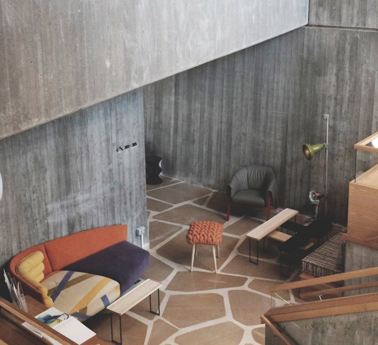 ...as the only visible remnant of the original interior, where now there is an awkward juxtaposition of rough concrete and over-designed decor. (Photo: Gili Merin)