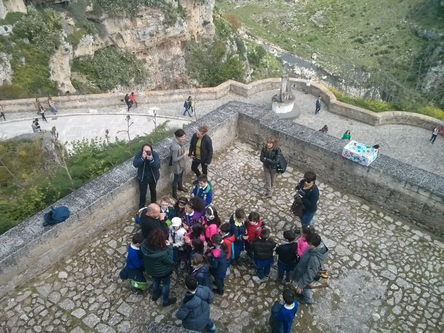 "Bembo Davies teaches a local school group the unMonastery's ""Morning Practice"" ritual on the balcony of the building. (Photo: Ben Vickers)"