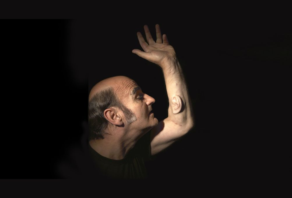 Stelarc's best known meat-machine experiment was his 2007 surgical attachment of a cell-cultivated human ear onto his forearm. (Photo: Nina Sellars)